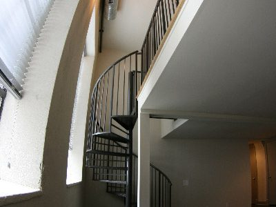 The Auction House Lofts spiral staircase