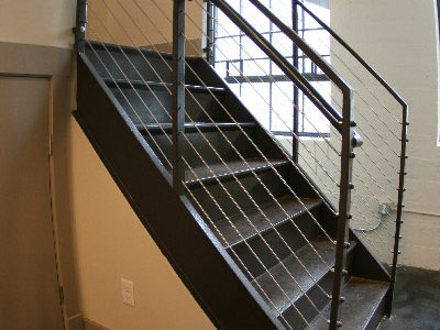 The Auction House Lofts apartment staircase